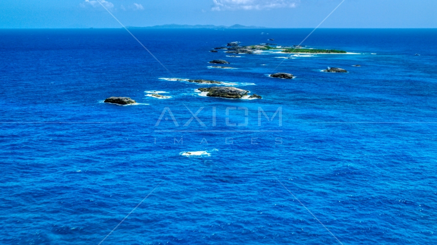Tiny Caribbean islands in tropical blue waters, Puerto Rico  Aerial Stock Photos | AX102_087.0000074F
