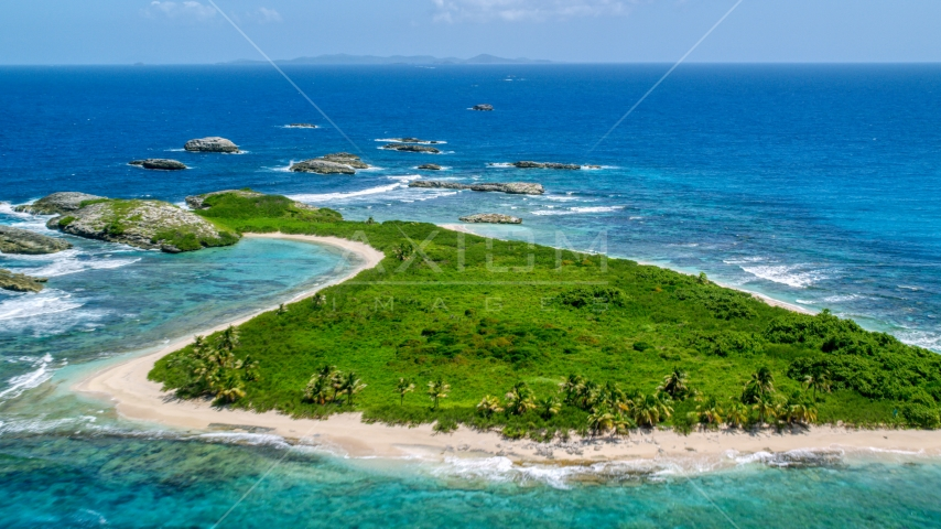 Tiny green island with beach in sapphire blue water, Puerto Rico  Aerial Stock Photos | AX102_089.0000033F