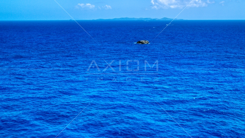 Tiny rocky island in sapphire blue ocean, Puerto Rico  Aerial Stock Photos | AX102_090.0000165F