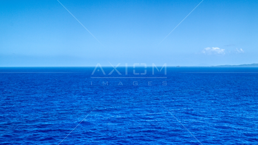 Sapphire ocean waters of the Atlantic Ocean  Aerial Stock Photos | AX102_094.0000000F