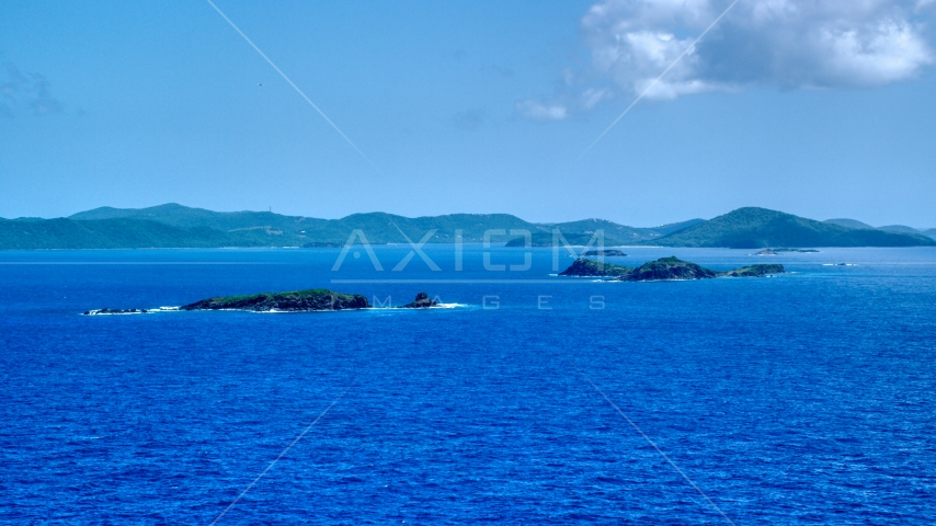 Cluster of small islands in sapphire blue waters near the Caribbean island of Culebra, Puerto Rico  Aerial Stock Photos | AX102_101.0000000F