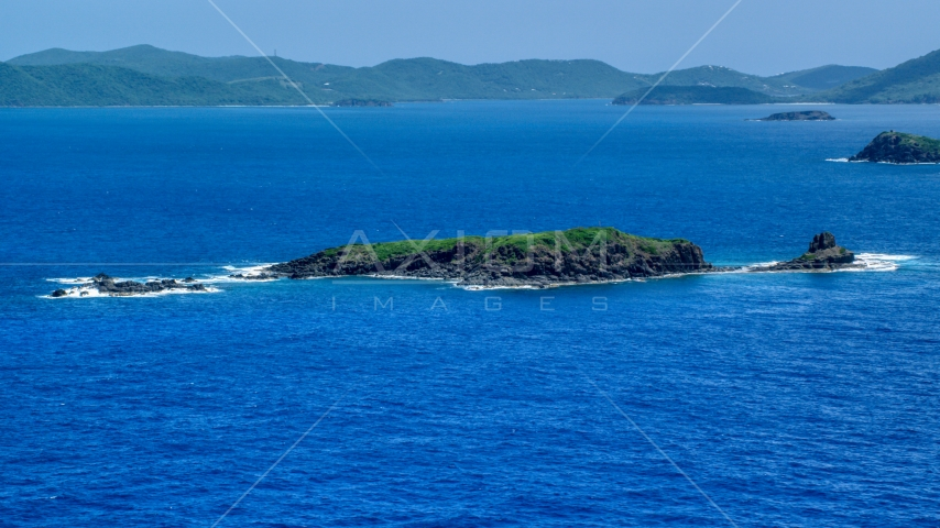 Small Caribbean island in sapphire blue waters near Culebra, Puerto Rico  Aerial Stock Photos | AX102_102.0000000F