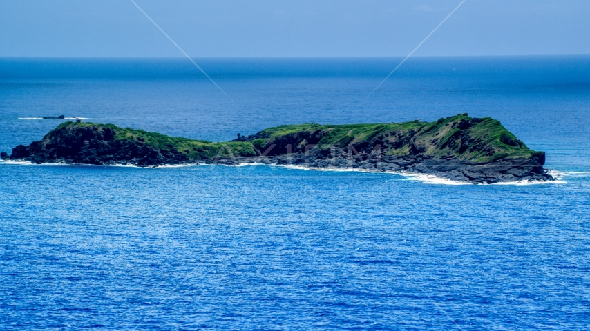 Small rocky green island in sapphire blue waters, Culebra, Puerto Rico  Aerial Stock Photos | AX102_104.0000000F