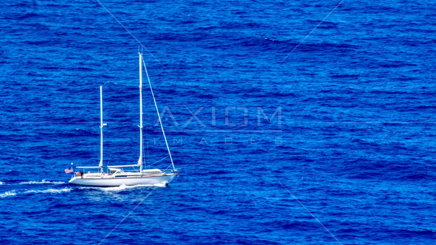 Sail boat in sapphire blue waters, Culebra, Puerto Rico  Aerial Stock Photos | AX102_106.0000000F
