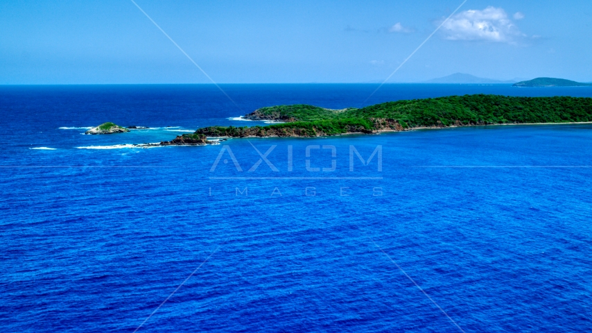Rugged Caribbean island coastline in sapphire blue water, Culebra, Puerto Rico  Aerial Stock Photos | AX102_107.0000000F
