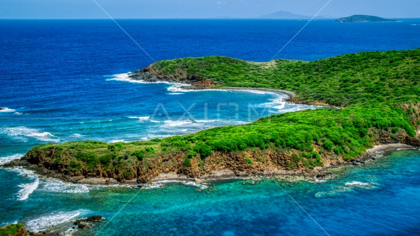 Rugged coastline of a tree covered Caribbean island in blue waters, Culebra, Puerto Rico Aerial Stock Photo AX102_108.0000000F | Axiom Images