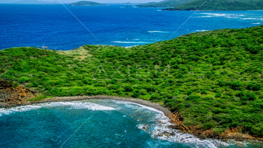 Tree covered Caribbean island coast of Culebra, Puerto Rico Aerial Stock Photos | AX102_108.0000211F