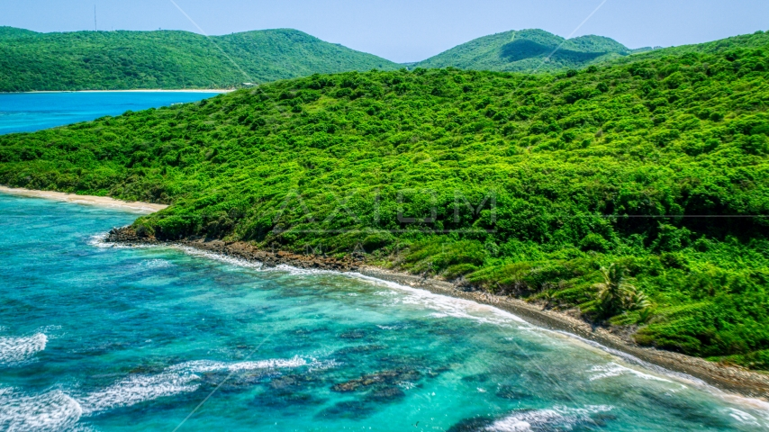 Blue ocean waters and a green island coastline in Culebra, Puerto Rico  Aerial Stock Photos | AX102_111.0000000F