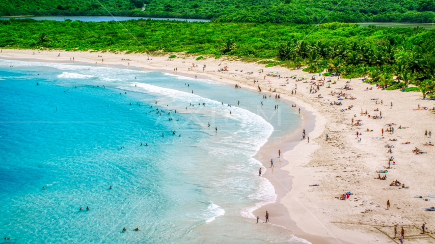 Sunbathers on a white sand Caribbean beach in Culebra, Puerto Rico  Aerial Stock Photos | AX102_112.0000187F