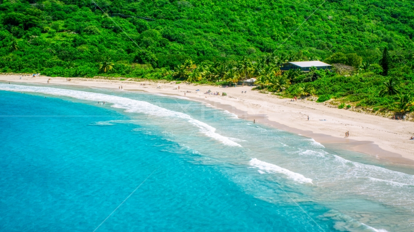 Sapphire blue waters by tourists on a white sand Caribbean beach, Culebra, Puerto Rico  Aerial Stock Photos | AX102_113.0000000F