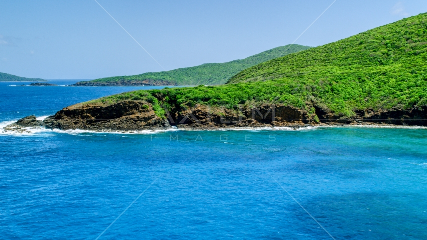 Sapphire blue waters and a rugged island coastline, Culebra, Puerto Rico  Aerial Stock Photos | AX102_115.0000000F