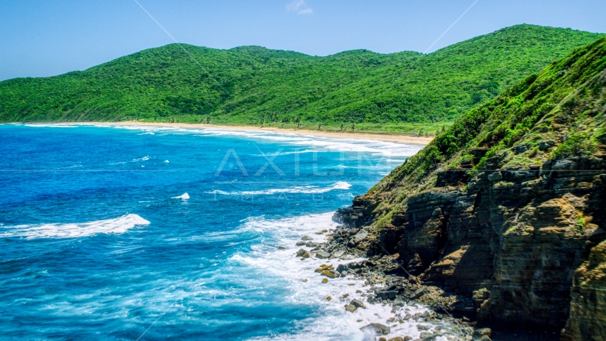 Sapphire blue waters and a Caribbean beach and lush vegetation, Culebra, Puerto Rico  Aerial Stock Photos | AX102_116.0000040F