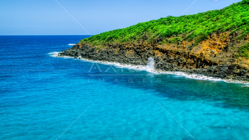 Sapphire blue waters on the rocky coast of Culebra, Puerto Rico Aerial Stock Photos | AX102_119.0000000F