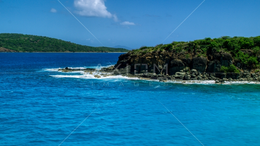 Sapphire blue waters and a rugged island coast in Culebra, Puerto Rico Aerial Stock Photos | AX102_126.0000000F