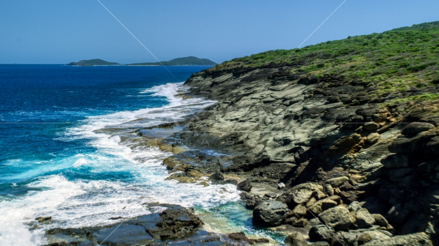 Waves crashing into a rugged island coast, Culebra, Puerto Rico Aerial Stock Photos | AX102_126.0000234F