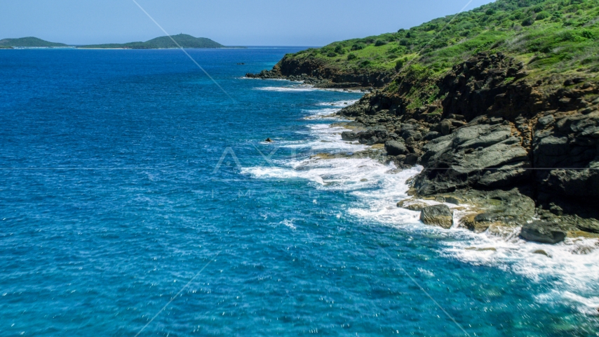 Sapphire blue waters and a rugged island coast, Culebra, Puerto Rico  Aerial Stock Photo AX102_128.0000116F | Axiom Images