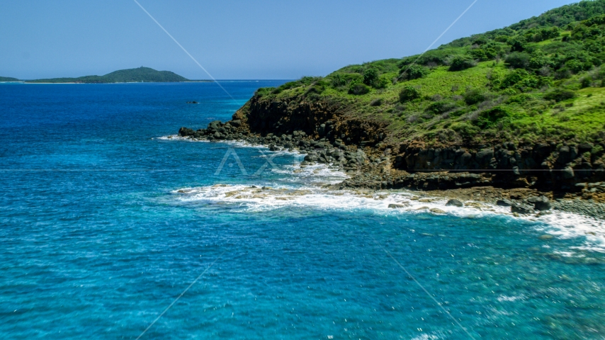 A rugged Caribbean island coast and blue water in Culebra, Puerto Rico  Aerial Stock Photos | AX102_128.0000342F