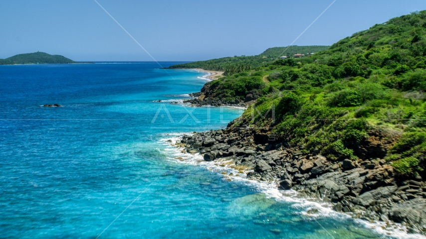 A coast with vegetation and sapphire blue waters, Culebra, Puerto Rico  Aerial Stock Photos | AX102_129.0000222F