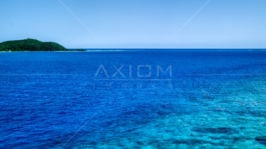 Turquoise ocean waters near a small island, Culebra, Puerto Rico Aerial Stock Photo AX102_132.0000290F | Axiom Images