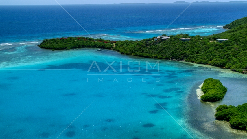 Oceanfront home on the Caribbean island coast of Culebra, Puerto Rico  Aerial Stock Photos | AX102_136.0000337F