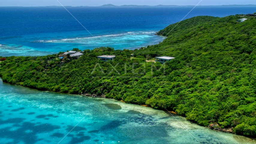 Oceanfront homes and trees overlooking sapphire blue waters, Culebra, Puerto Rico  Aerial Stock Photos | AX102_137.0000000F