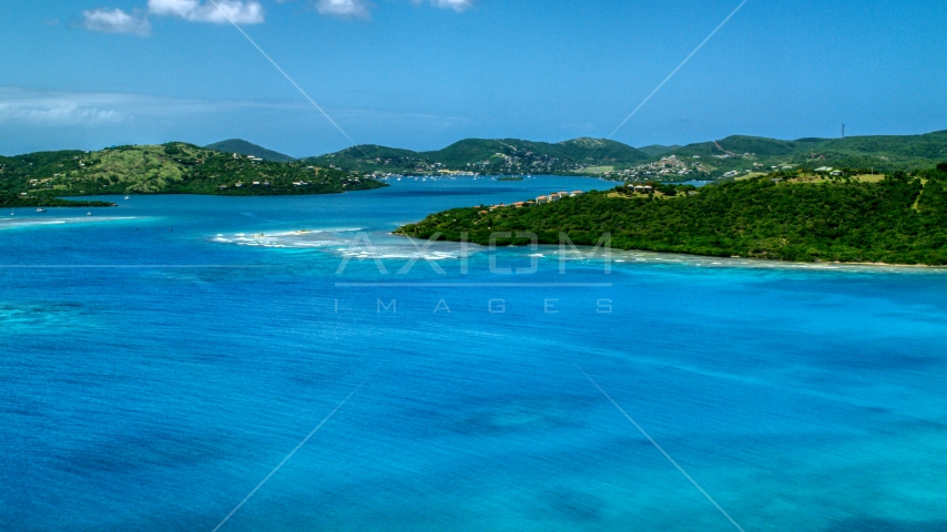 Hilltop homes overlooking sapphire blue waters near a coastal town, Culebra, Puerto Rico  Aerial Stock Photo AX102_138.0000238F | Axiom Images