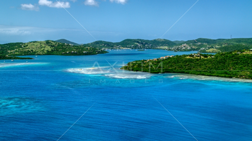 Sapphire blue bay and a coastal island town on Culebra, Puerto Rico  Aerial Stock Photos | AX102_139.0000000F