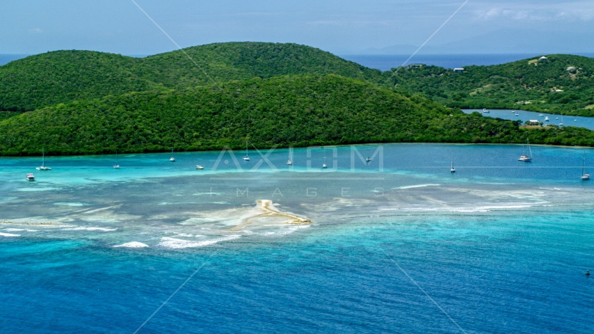 Sailboats in turquoise waters beside a tree covered island coast, Culebra, Puerto Rico  Aerial Stock Photos | AX102_140.0000000F