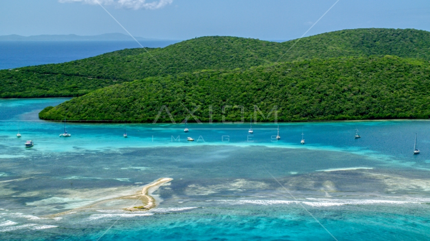Sailboats in turquoise waters beside a Caribbean island coast, Culebra, Puerto Rico  Aerial Stock Photos | AX102_140.0000148F