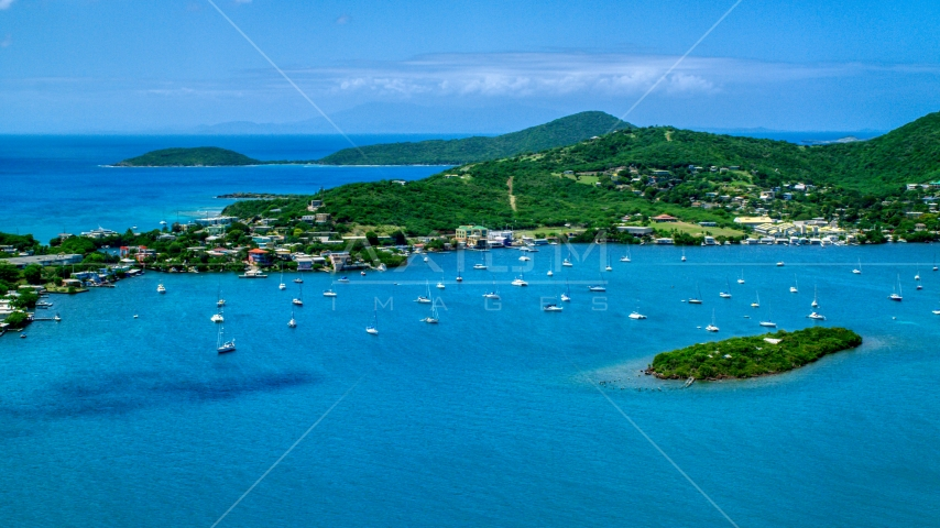 Sail boats in sapphire blue water near a small coastal town, Culebra, Puerto Rico  Aerial Stock Photos | AX102_142.0000000F