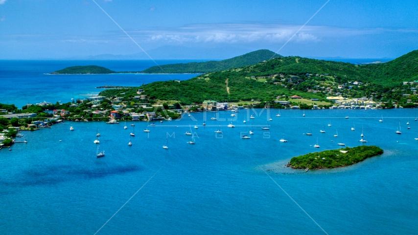 Sail boats in sapphire blue water near a small coastal town, Culebra, Puerto Rico  Aerial Stock Photo AX102_142.0000000F | Axiom Images