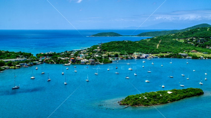 Sailing boats in sapphire blue water near a coastal town, Culebra, Puerto Rico  Aerial Stock Photos | AX102_142.0000195F