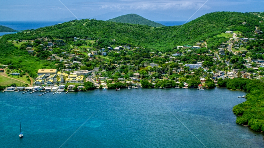 Coastal town with small factory beside blue waters, Culebra, Puerto Rico  Aerial Stock Photos | AX102_143.0000190F