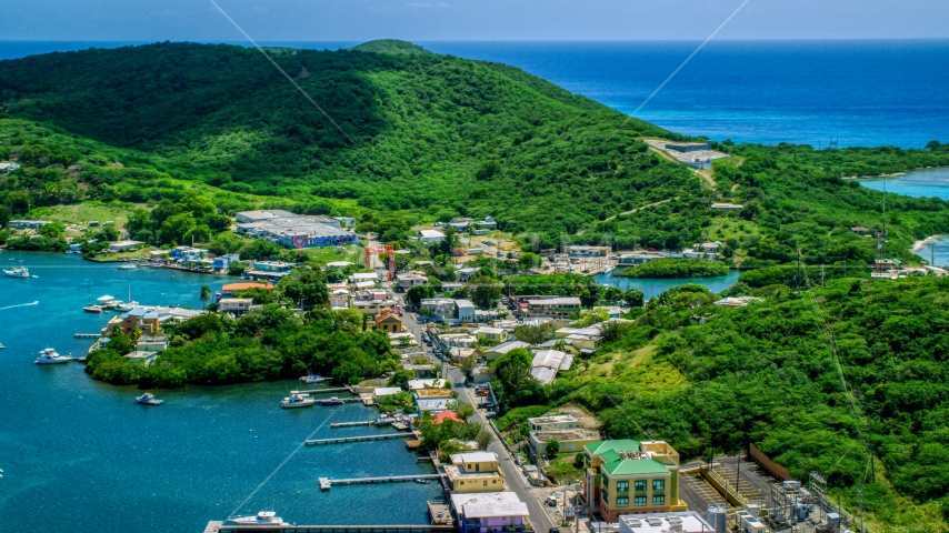 Small shops in a coastal town in Culebra, Puerto Rico Aerial Stock Photo AX102_145.0000055F | Axiom Images
