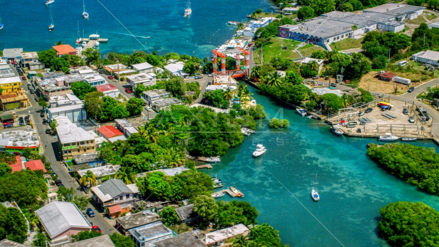 Coastal town with a small bridge in Culebra, Puerto Rico  Aerial Stock Photos | AX102_146.0000302F