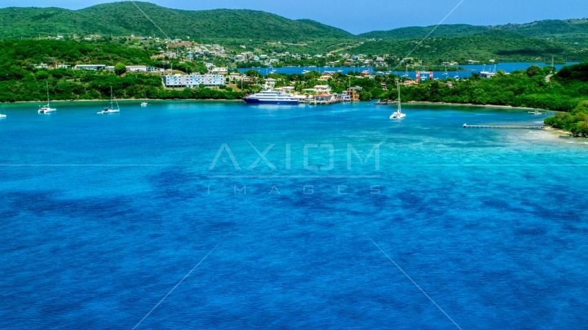 Ferry in the sapphire blue bay by a coastal town, Culebra, Puerto Rico  Aerial Stock Photos | AX102_148.0000000F