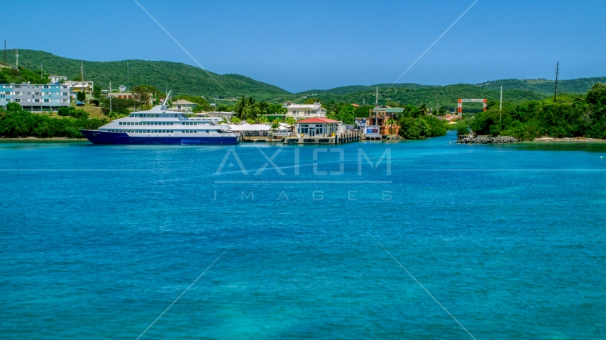 Docked ferry in sapphire blue bay by the coast, Culebra, Puerto Rico  Aerial Stock Photos | AX102_149.0000236F