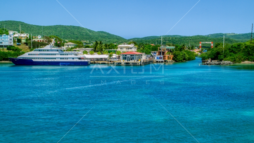 Ferry docked in sapphire waters by a waterfront town, and Culebra, Puerto Rico  Aerial Stock Photos | AX102_150.0000000F