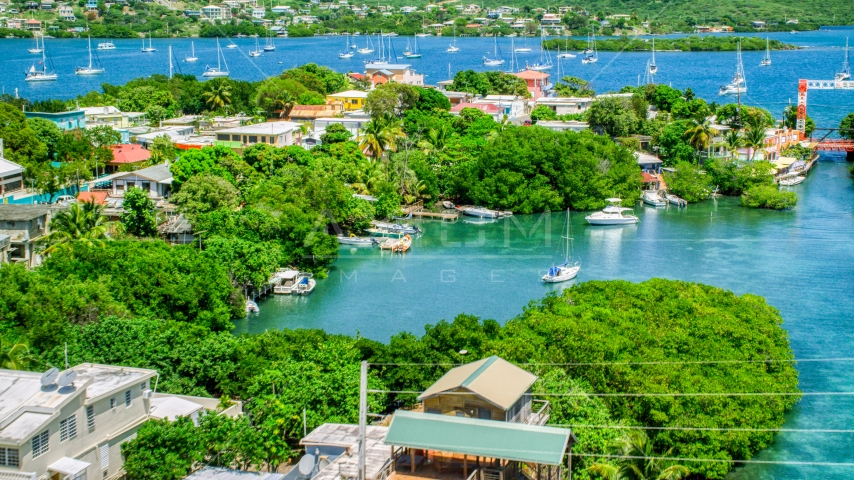 Boats in a cove at a small oceanside island town, Culebra, Puerto Rico  Aerial Stock Photos | AX102_151.0000000F