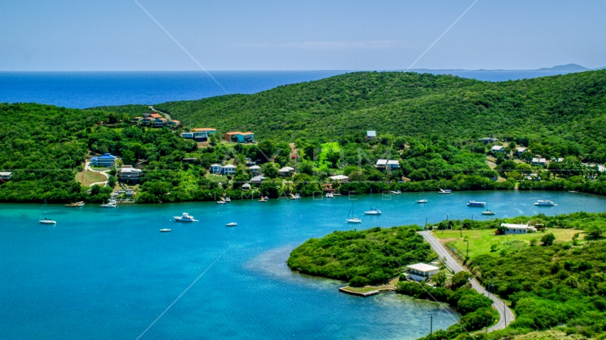 Oceanfront island homes overlooking sapphire waters, Culebra, Puerto Rico Aerial Stock Photo AX102_155.0000000F | Axiom Images