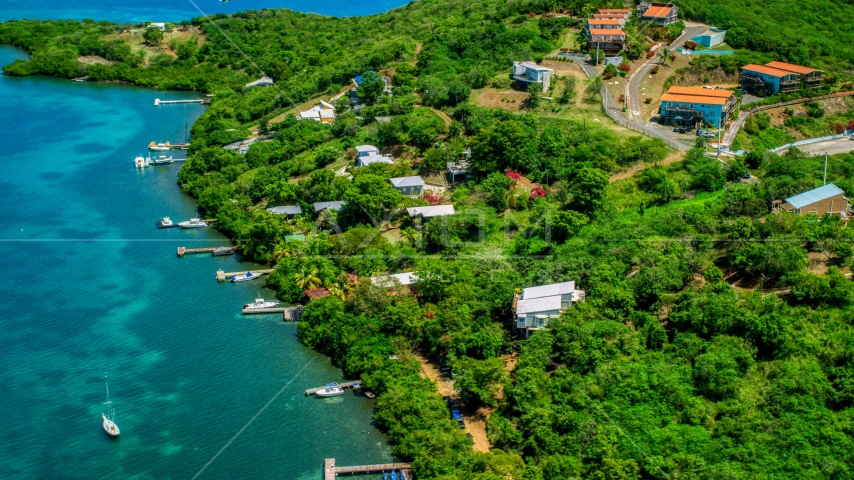 Oceanfront homes and docks along the coast and sapphire waters, Culebra, Puerto Rico Aerial Stock Photos | AX102_157.0000125F