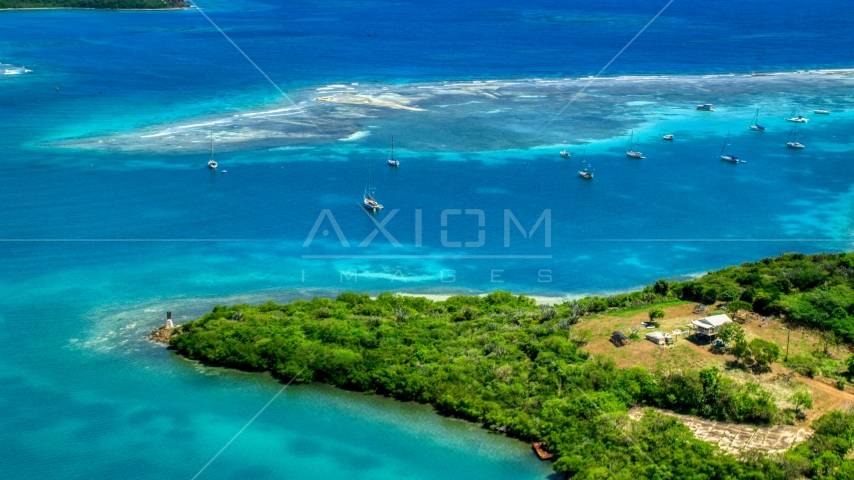 Sailboats near a reef in sapphire blue waters of a harbor Culebra, Puerto Rico  Aerial Stock Photo AX102_159.0000283F | Axiom Images