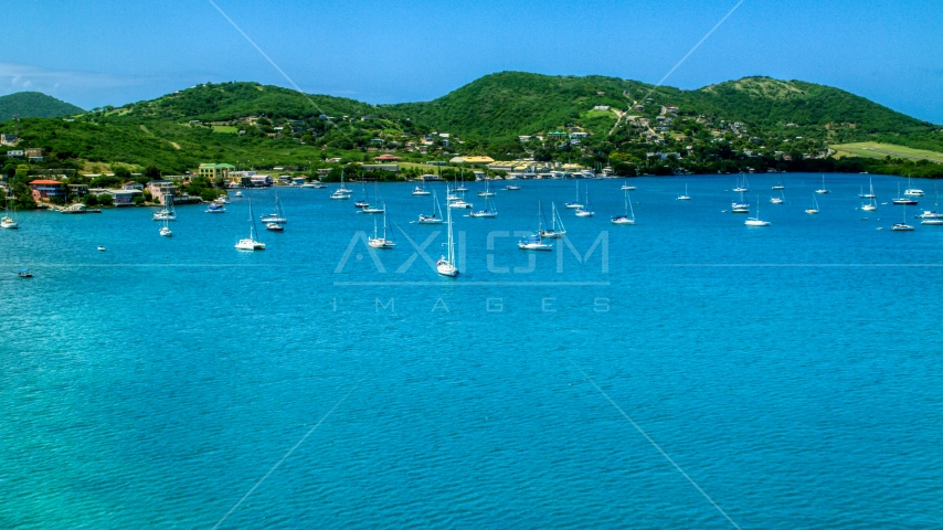 Sailboats in sapphire blue harbor near the coastal island town on Culebra, Puerto Rico  Aerial Stock Photos | AX102_161.0000000F