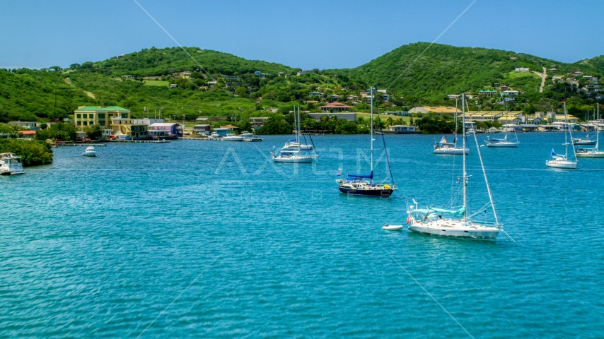 Sailboats in the harbor near the small island town in Culebra, Puerto Rico Aerial Stock Photo AX102_162.0000091F | Axiom Images