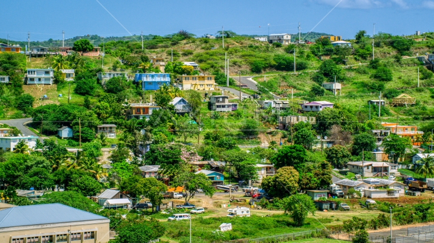 Hillside homes on the Caribbean island of Culebra, Puerto Rico  Aerial Stock Photo AX102_165.0000225F | Axiom Images