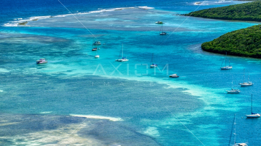 Sailboats anchored in the harbor near reefs in Culebra, Puerto Rico  Aerial Stock Photo AX102_169.0000228F | Axiom Images