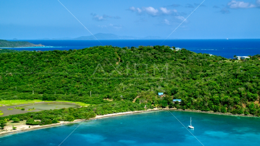 A view of hilltop and oceanfront homes in Culebra, Puerto Rico Aerial Stock Photos | AX102_170.0000000F