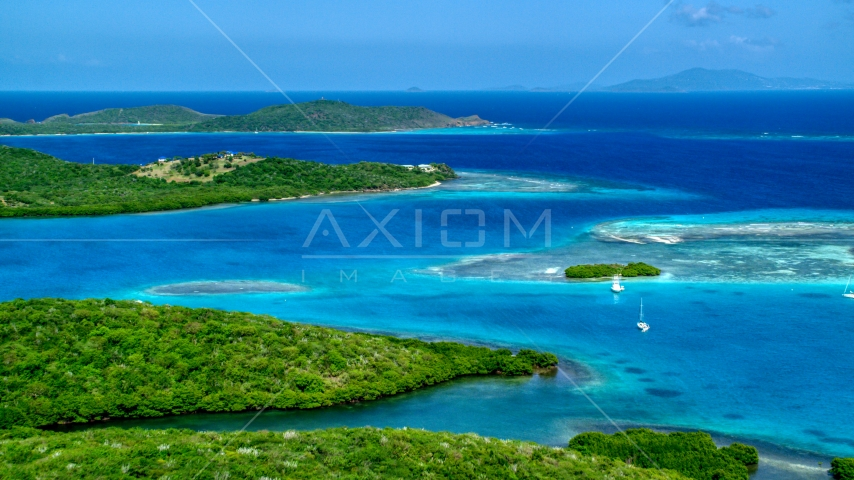 Boats anchored off the Caribbean island coast in Culebra, Puerto Rico Aerial Stock Photo AX102_171.0000213F | Axiom Images