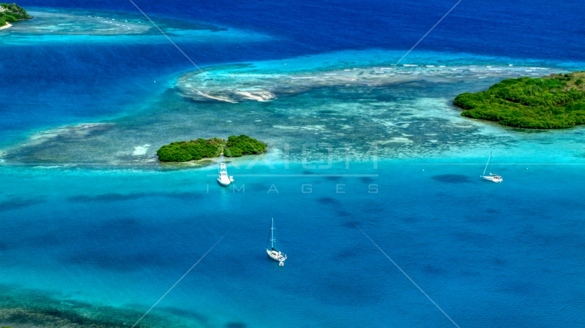 Boats near a reef in turquoise Caribbean waters, Culebra, Puerto Rico Aerial Stock Photo AX102_172.0000000F | Axiom Images
