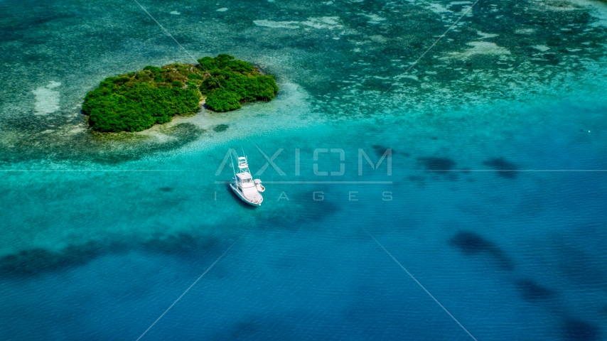 Fishing boat anchored near a reef and tiny Caribbean island, Culebra, Puerto Rico Aerial Stock Photo AX102_172.0000132F | Axiom Images
